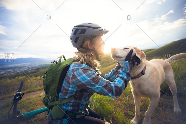 A Woman Loving Her Dog At The Bonneville Shoreline Trail, Utah