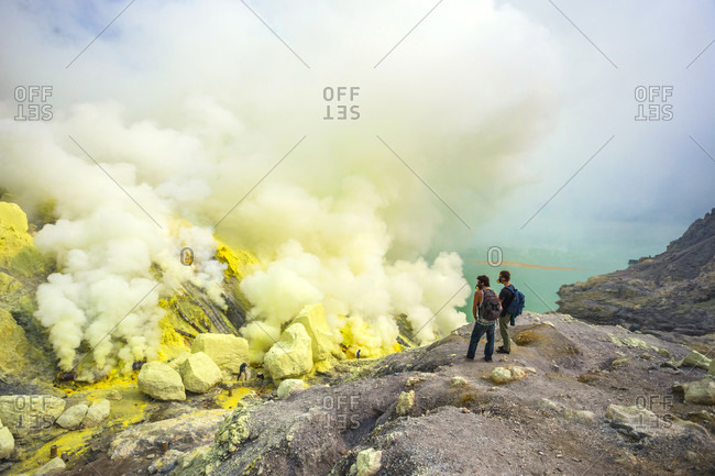 Two Male Hikers In Volcano Kawah Ijen, Java, Indonesia