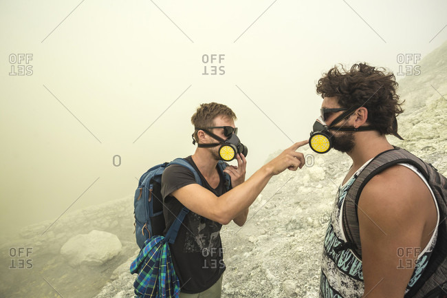 Two Male Hikers checking their air filters In Volcano Kawah Ijen, Java, Indonesia