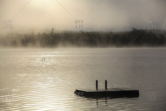 Morning Mist And A Dock On A Lake In Northern Maine