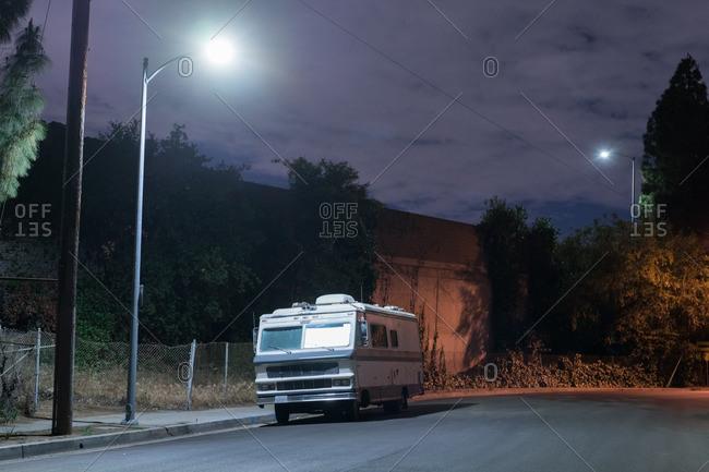May 7, 2016 - Los Angeles, California: Vintage camper parked beneath street light
