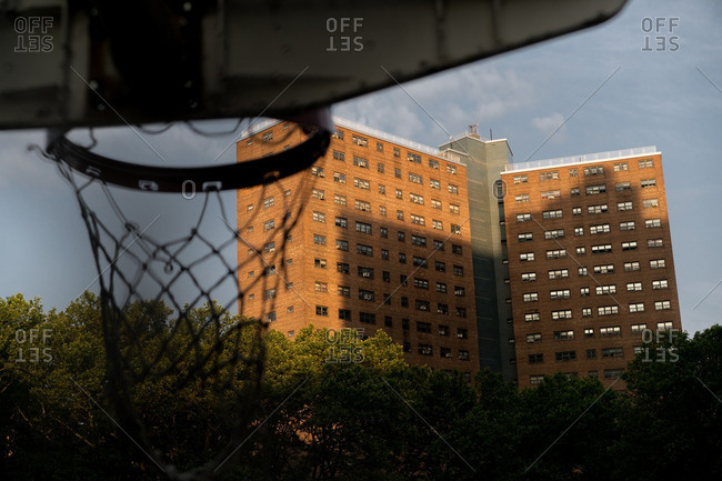 Basketball net with view of public housing project