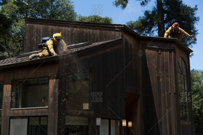 July 31, 2016 - Big Sur, California: Firefighters working to minimize risk to a house in the path of the Soberanes wildfire