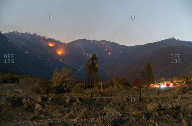 Glow of wildfires on hills in the San Bernardino Forest
