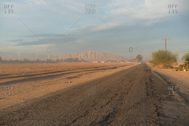 Road through dusty desert town