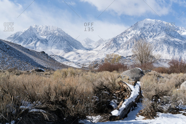 Snowy mountains in desert landscape
