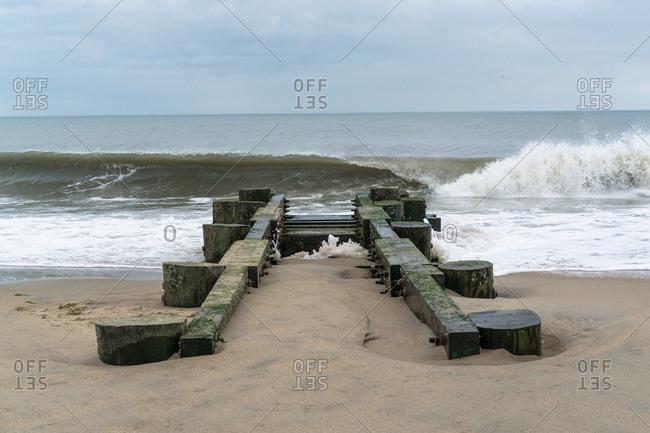 Manmade jetty on beach