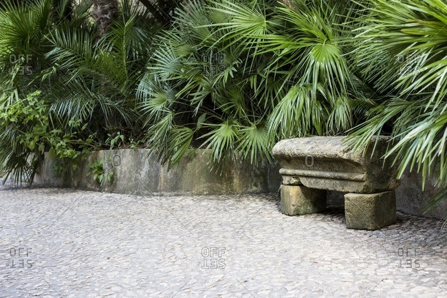 Quiet bench on garden path, Le Roque-Gageac, Dordogne, France