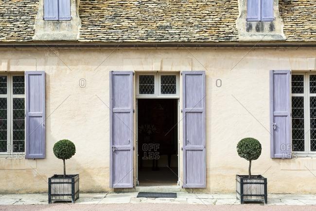 Purple shutters and shrubbery at Chateau de Marqueyssac, Les Jardins de Marqueyssac, Dordogne, France