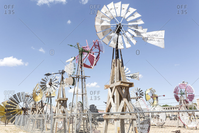 Portales, New Mexico - August 23, 2016: Windmill collection and folk art outside