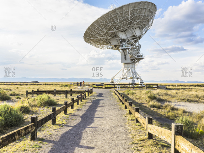 Socorro, New Mexico - August 24, 2016: People on path looking at telescope, Karl G. Jansky Very Large Array
