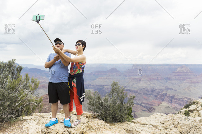 Grand Canyon, Arizona - August 26, 2016: Colorfully dressed couple taking selfie, Desert View Drive, Grand Canyon National Park