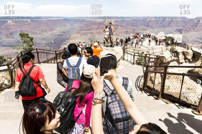 Grand Canyon, Arizona - August 26, 2016: Many tourists photographing and enjoying the view