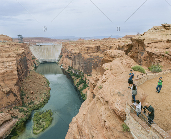 Page, Arizona - September 7, 2016: Tourists taking pictures from overlook at Glen Canyon Dam, Glen Canyon National Recreation Area