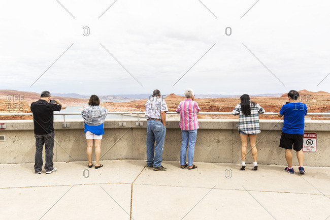 Page, Arizona - August 27, 2016: Tourists looking at Lake Powell from behind railing, Glen Canyon National Recreation Area