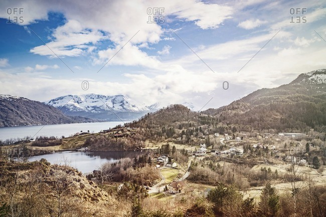 Scenic view of mountain, fjord, and village in Norway
