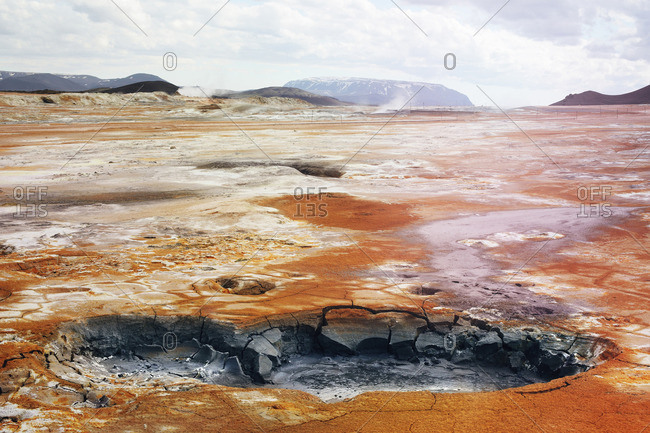 Mud pots and fumaroles in volcanic landscape in Iceland