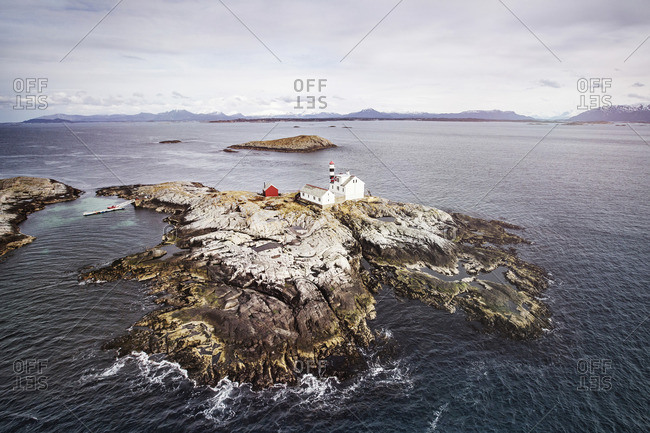 Rocky island with lighthouse off the coast of Norway
