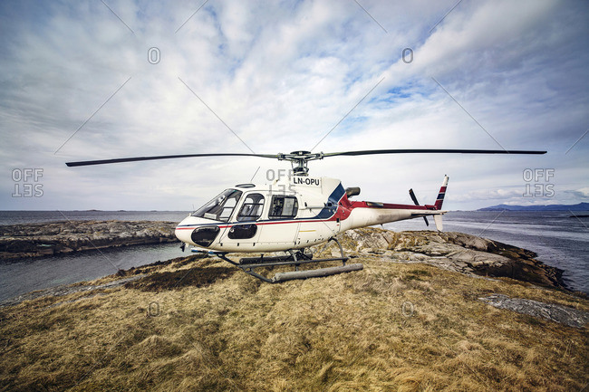 Norway - January 7, 2017: Helicopter landed on rocky island
