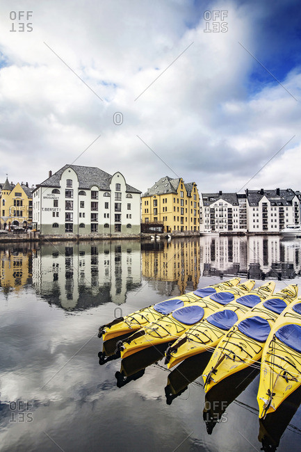 Alesund, Norway - January 7, 2017: Kayaks moored along river in front of hotel