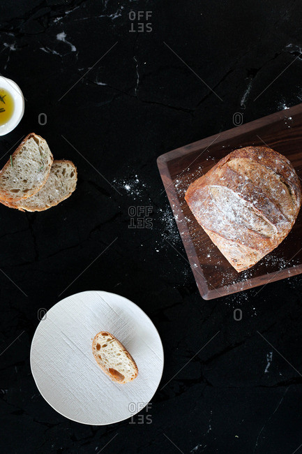 Loaf of fresh bread with olive oil for dipping