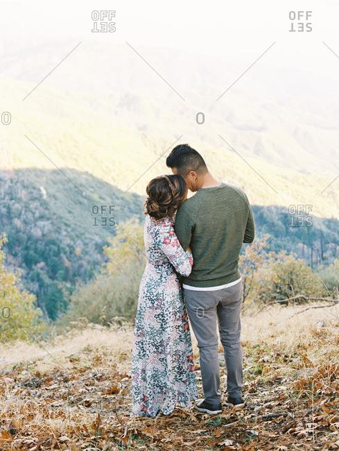 Romantic couple on hillside overlooking valley