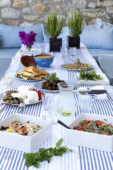 Outdoor table with traditional Greek food