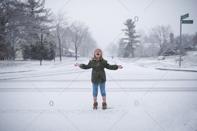 Girl in middle of street in snow fall