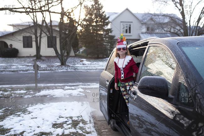 Girl in van in Christmas outfit