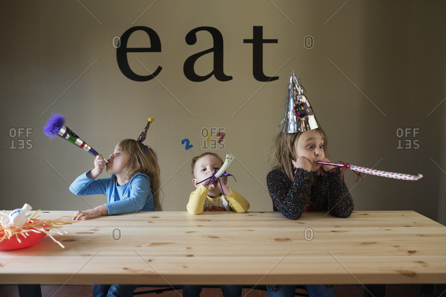 Kids with New Year's party favors