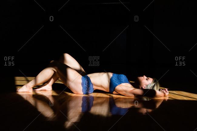 Woman in underwear in sunlight