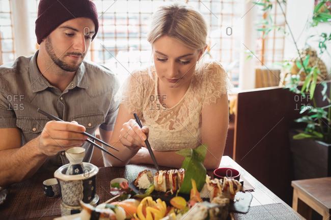 Couple having sushi in restaurant