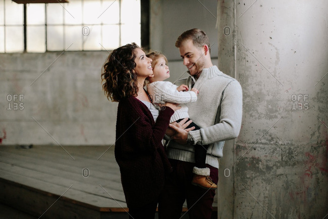 Family of three in old building