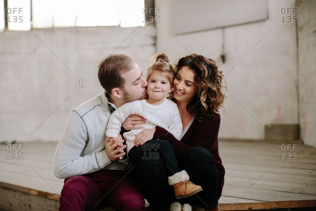 Loving parents with girl in building