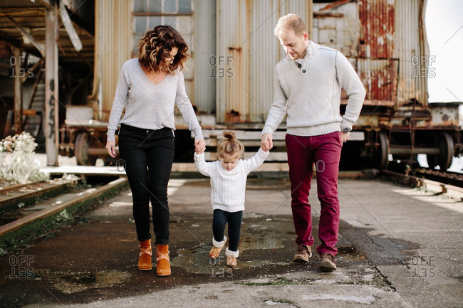 Family of three walking in industrial setting