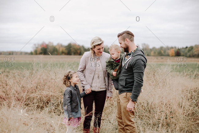 Family of four in a rural field