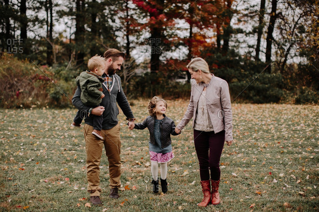 Happy family in fall countryside