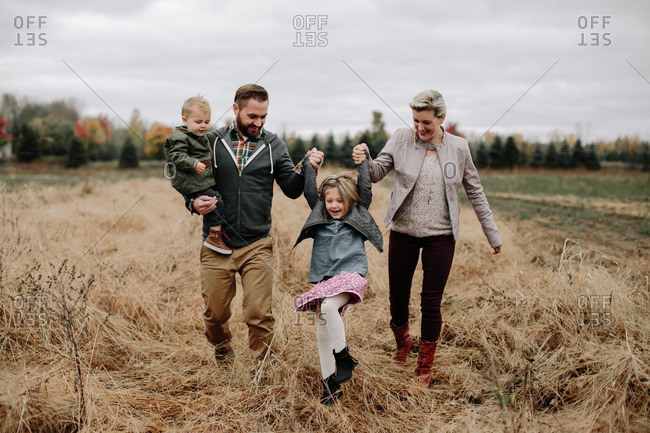 Playful family in autumn field
