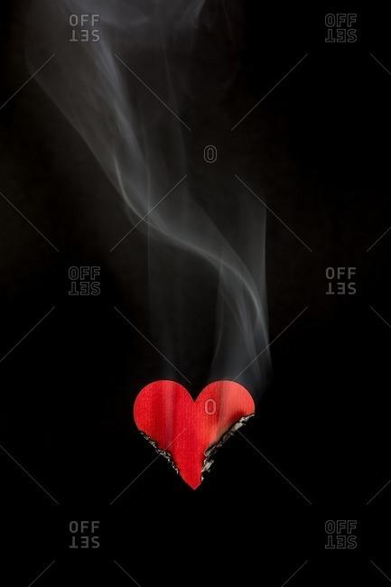 Burning heart on black