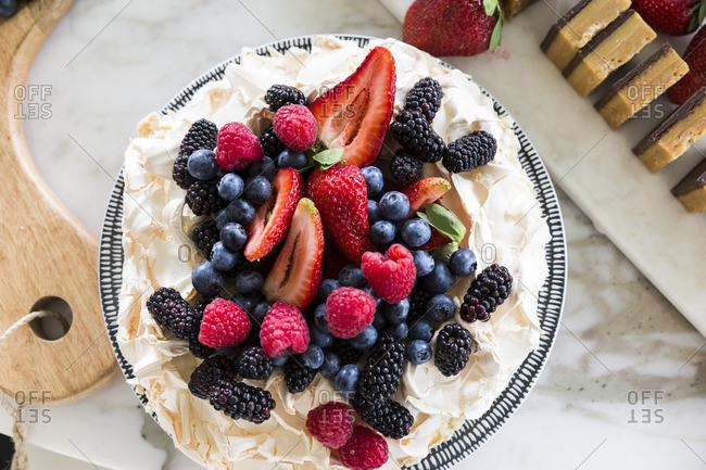 Berries on top of meringue pie