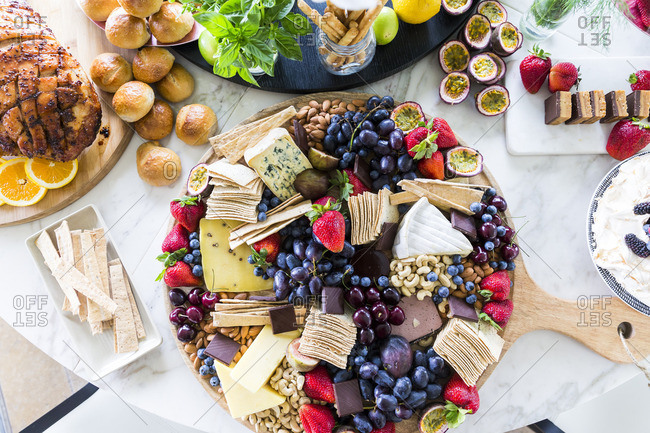 Cheese and fruit board on table