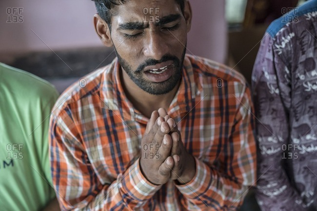 Udaipur, India - June 28, 2016: Minority Christian men worshiping in church in India