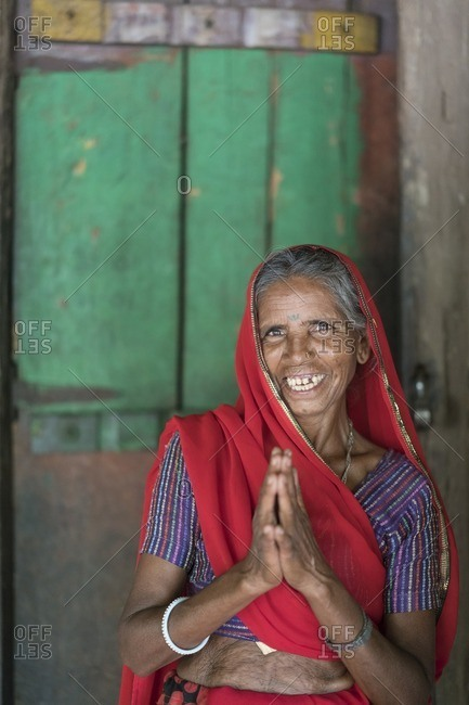 Udaipur, India - June 29, 2016: Elderly woman offers a Namaste greeting in Udaipur, India