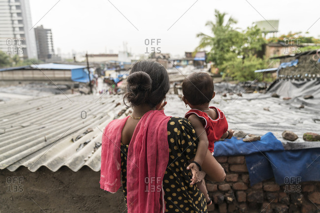 A woman and her child look out over the brothels in Mumbai, India