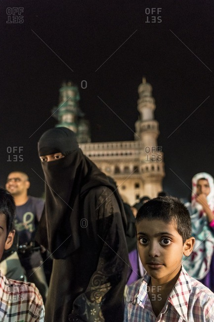 Hyderabad, India - July 4, 2016: Group of people walking by the Charminar Towers during Ramadan in Hyderabad