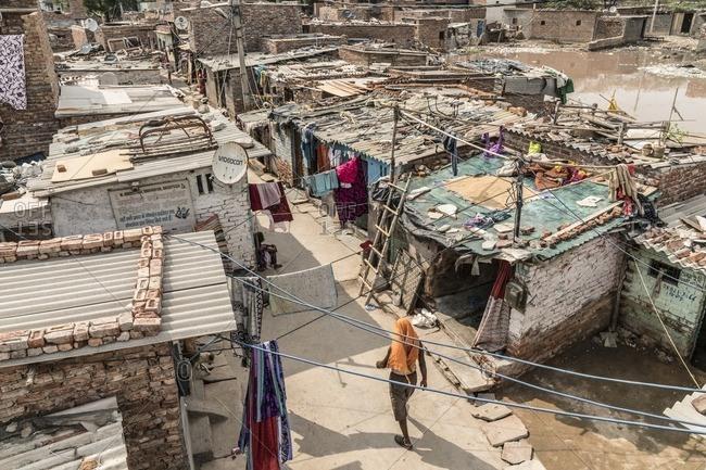 Delhi, India - July 5, 2016: Houses in a poor neighborhood in Delhi, India