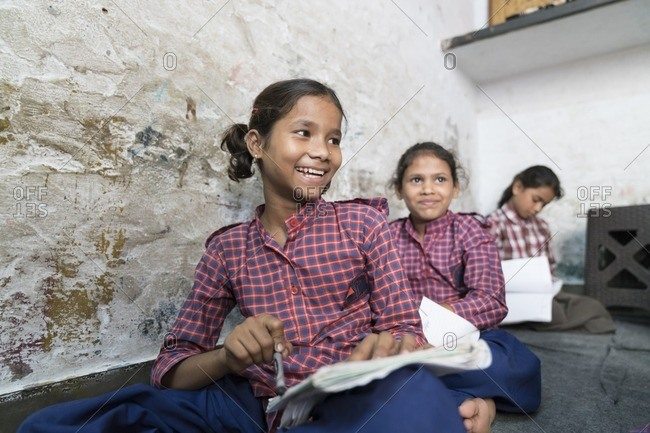 Delhi, India - July 5, 2016: Young girls in a class in India
