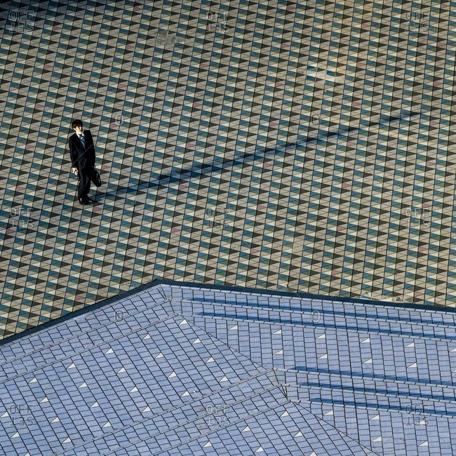Tokyo, Japan - December 2, 2016: Businessman in Tokyo heading home after work
