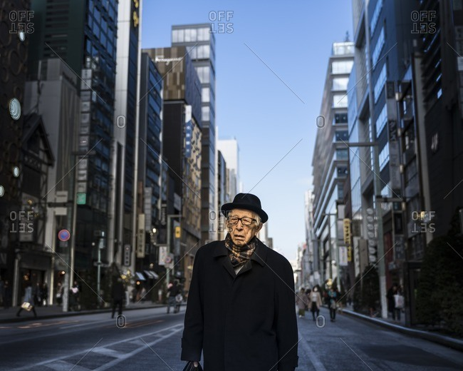 Tokyo, Japan - December 3, 2016: Senior businessman in Tokyo, Japan walking home after work