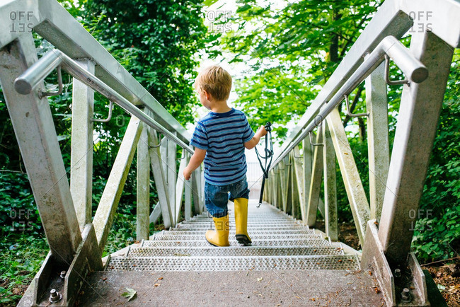 Boy going down steps in country